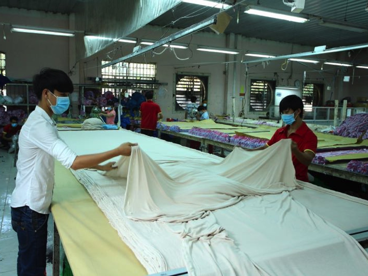 Cutting Fabric in Long Ha Chin